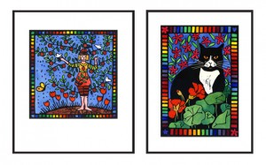 "Lino prints in black frames: ""Thriving"" (woman combined with a plum tree) and ""Black and White Cat in the Garden"". Both lino prints have rainbow borders."