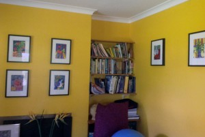 Daffodil yellow walls featuring several Tangerine Meg art prints