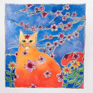 An orange cat sitting amongst the spring blossoms with a blue sky backdrop