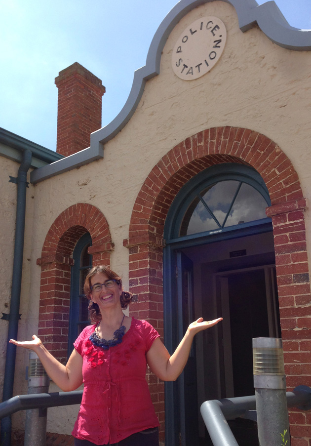 Tangerine Meg on the steps of the old Goolwa Police Station;