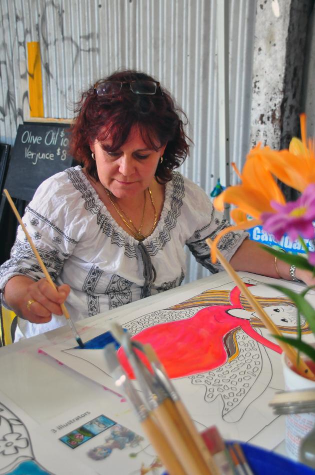 Priscilla and her artwork in progress