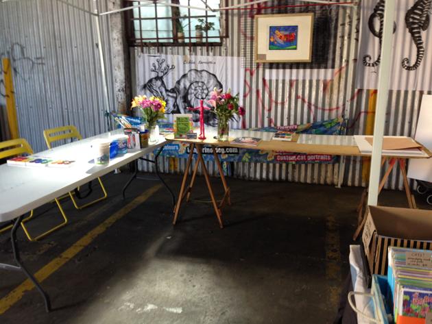 trestle tables set up for art workshop in the big shed at flinders street market