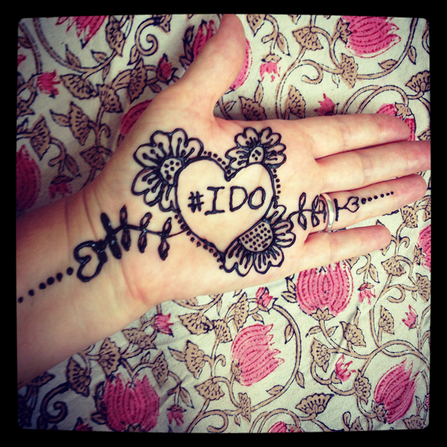henna hand with #ido and background of flower fabric