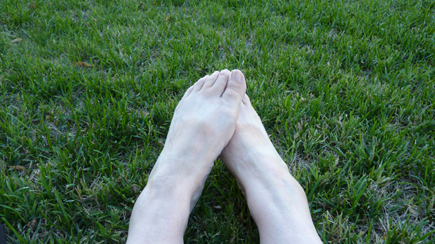 happy bare feet on very green grass