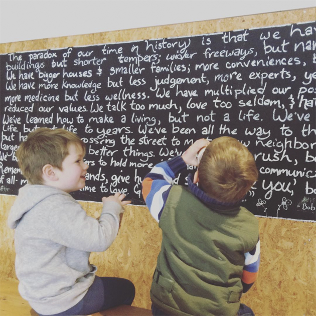 boys by a blackboard
