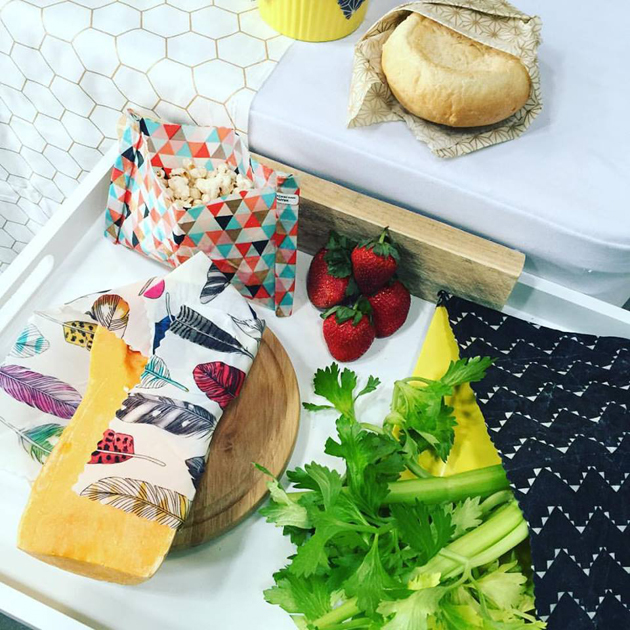 Ploughman's Lunch with bread, cheese, celery, strawberries and popcorn, arranged with patterned food wraps.