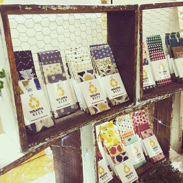 Reusable food wraps displayed on Recycled bee boxes