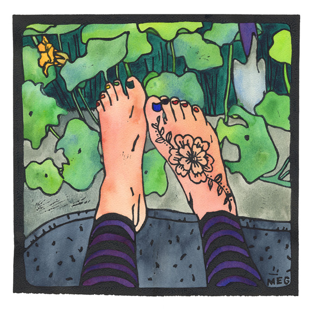 Legs in leggings with pale bare henna-ed feet, on a blanket beside a nasturtium garden