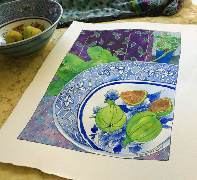 "Angled shot of ""Early Figs in Blue and White Bowl"" painting laid on a swrily yellow-ish table surface, with actual bowl and figs towards the back and to the left."