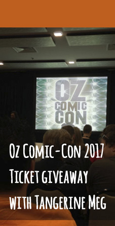 Photo of audience members awaiting a talk by favourite actor, in the meantime a screen displays the 2014 Oz Comic-Con logo. Header overlays.
