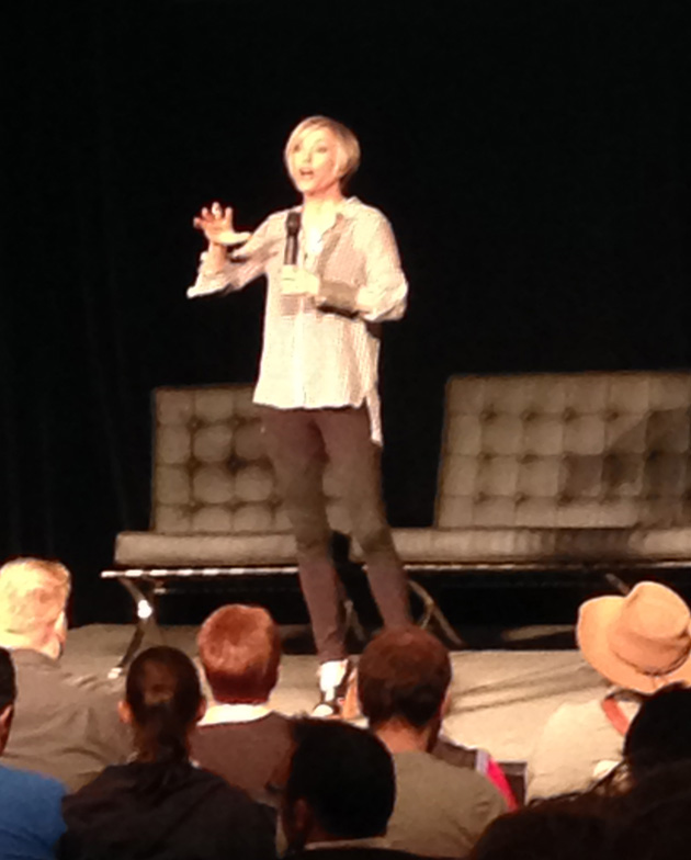 Nana Visitor, Star Trek DS9 actress, on stage at Oz Comic-Con in 2014. A few audience heads are visible in the foreground