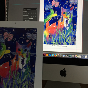 an art calendar page featuring a rainbow cat painting, and the matching cat art picture on a computer screen