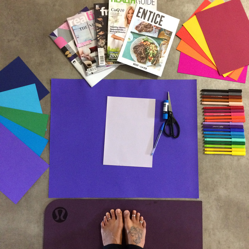 yoga feet with a cool tat surrounded by colourful creating materials