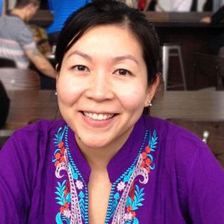 Juanita Tortilla smiling, looking at camera, wearing a purple top
