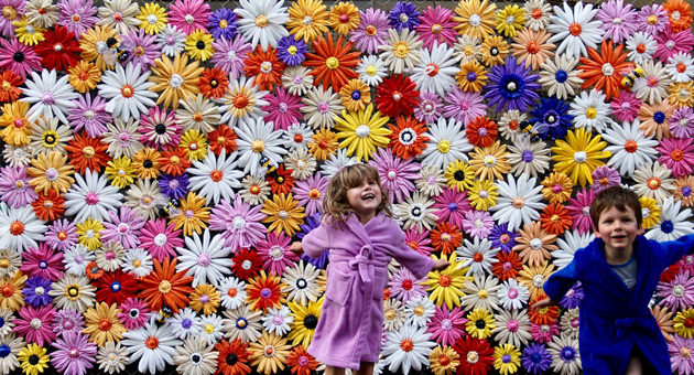 This is just a big arse wall of flowers I made for the Little Rundle Street Art Project during Fringe this year, drawing attention to the fact that bees need flowers. It was hand made from woven and crocheted plastic bags and was the mother of all works to date.