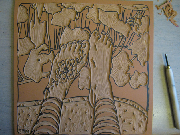 Lino tool alongside carved lino block picture of feet
