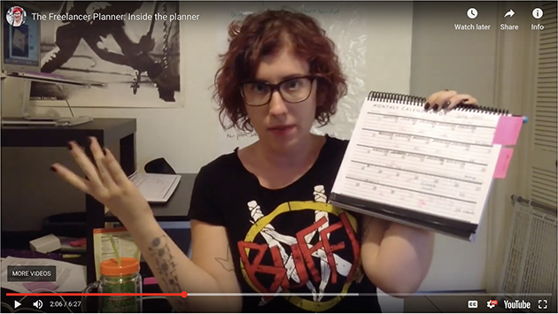 Screen shot of Michelle Nickolaisen demonstrating the Freelancer Planner while wearing a Buffy t-shirt