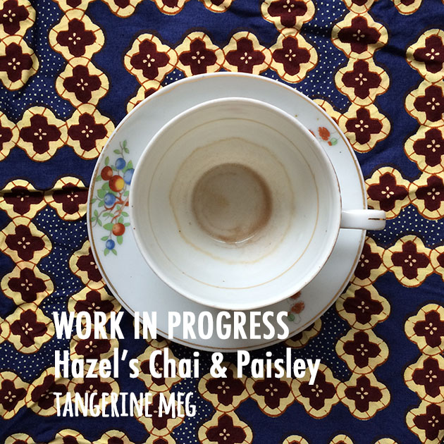 Photograph with a top view of a white china cup and saucer with tree design, with marks showing the gradual drainage of the cup. The background is a blue, cream and deep red/brown patterned fabris. The blog post text is overlaid in white.